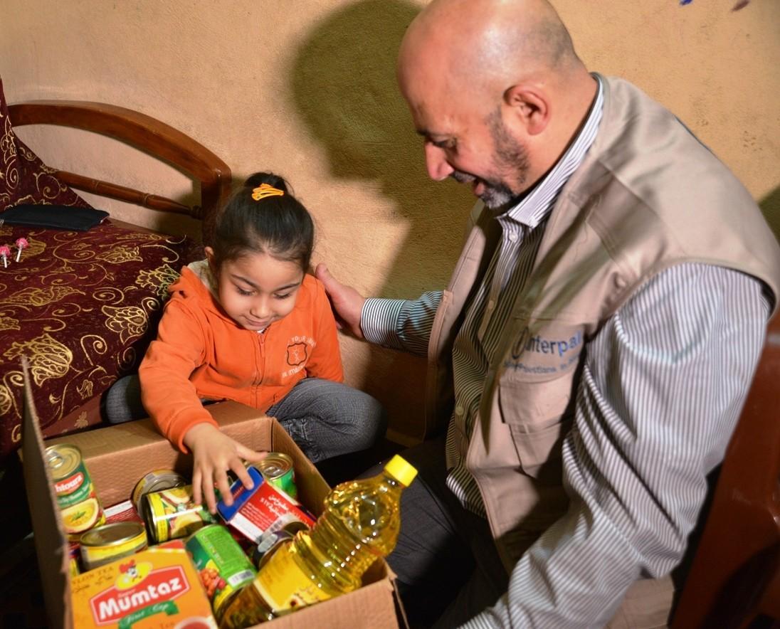 Delivering winter food parcels to Palestinian refugees in Lebanon, December 2014