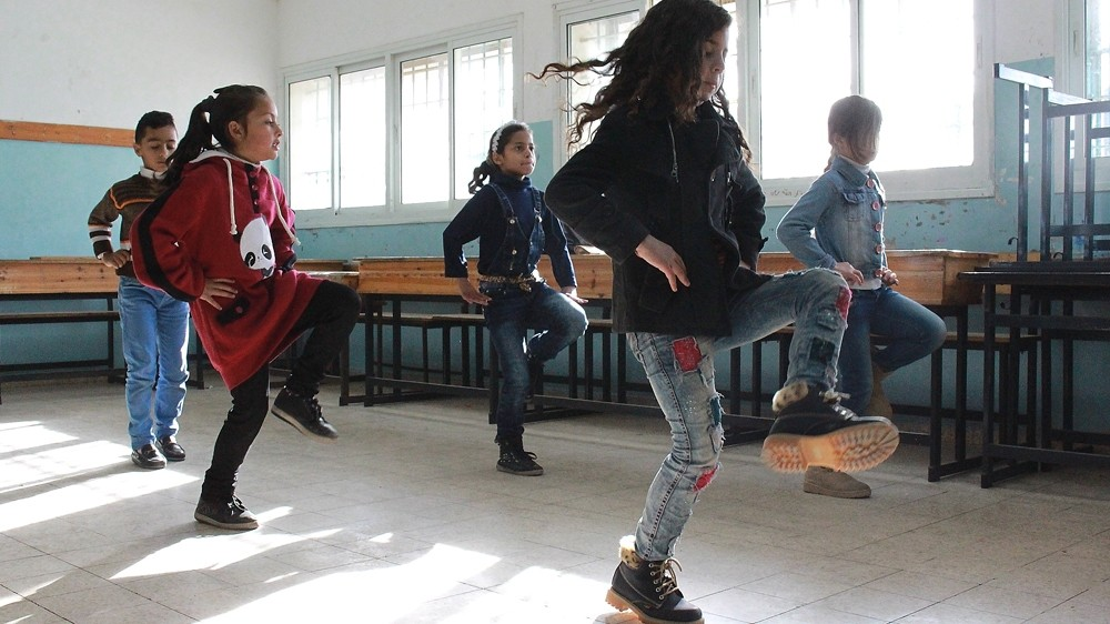 Sounds of Palestine offers a class that teaches Dabka, a lively, traditional Palestinian dance [Julie Ovgaard/Al Jazeera]