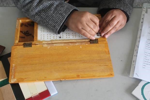 Abeer using the Perkins Brailler.