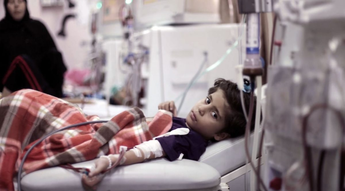 Sick Palestinian girl in a hospital bed