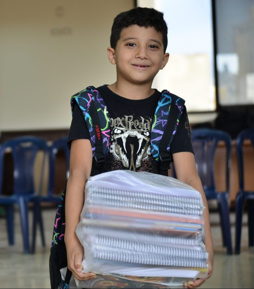Interpal Education Aid - Palestinian Child Carrying Books
