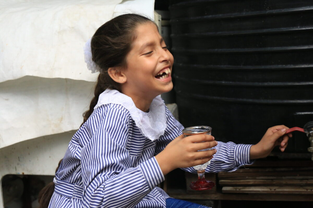 Palestinian girl dirnking water provided by Interpal