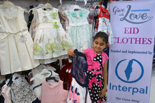 A Palestinian child shops for an Eid dress, made possible through Interpal's Eid Gift programme.