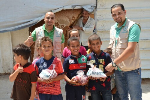 Interpal staff delivering fresh Qurbani meat to Palestinian refugee families.